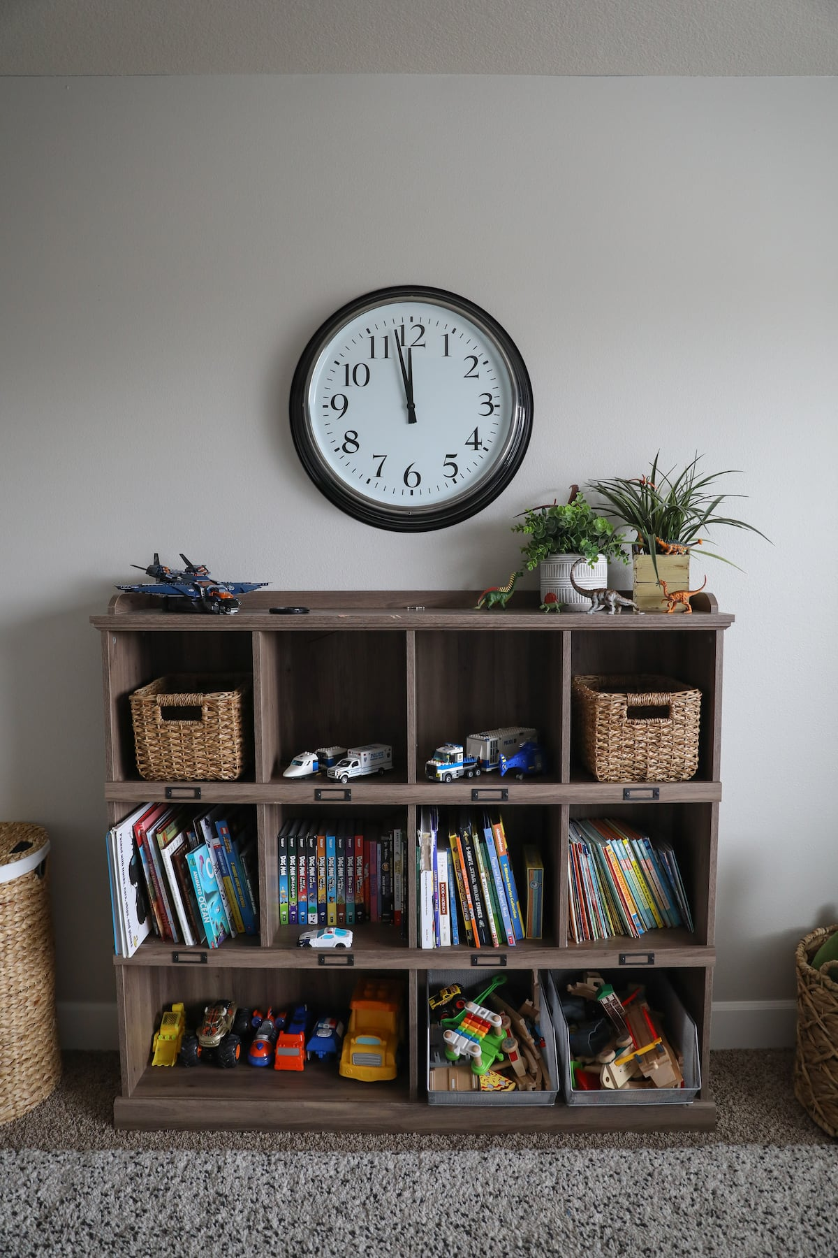 book shelf with books and toys