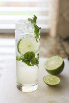 two mojito mocktails on white cutting board