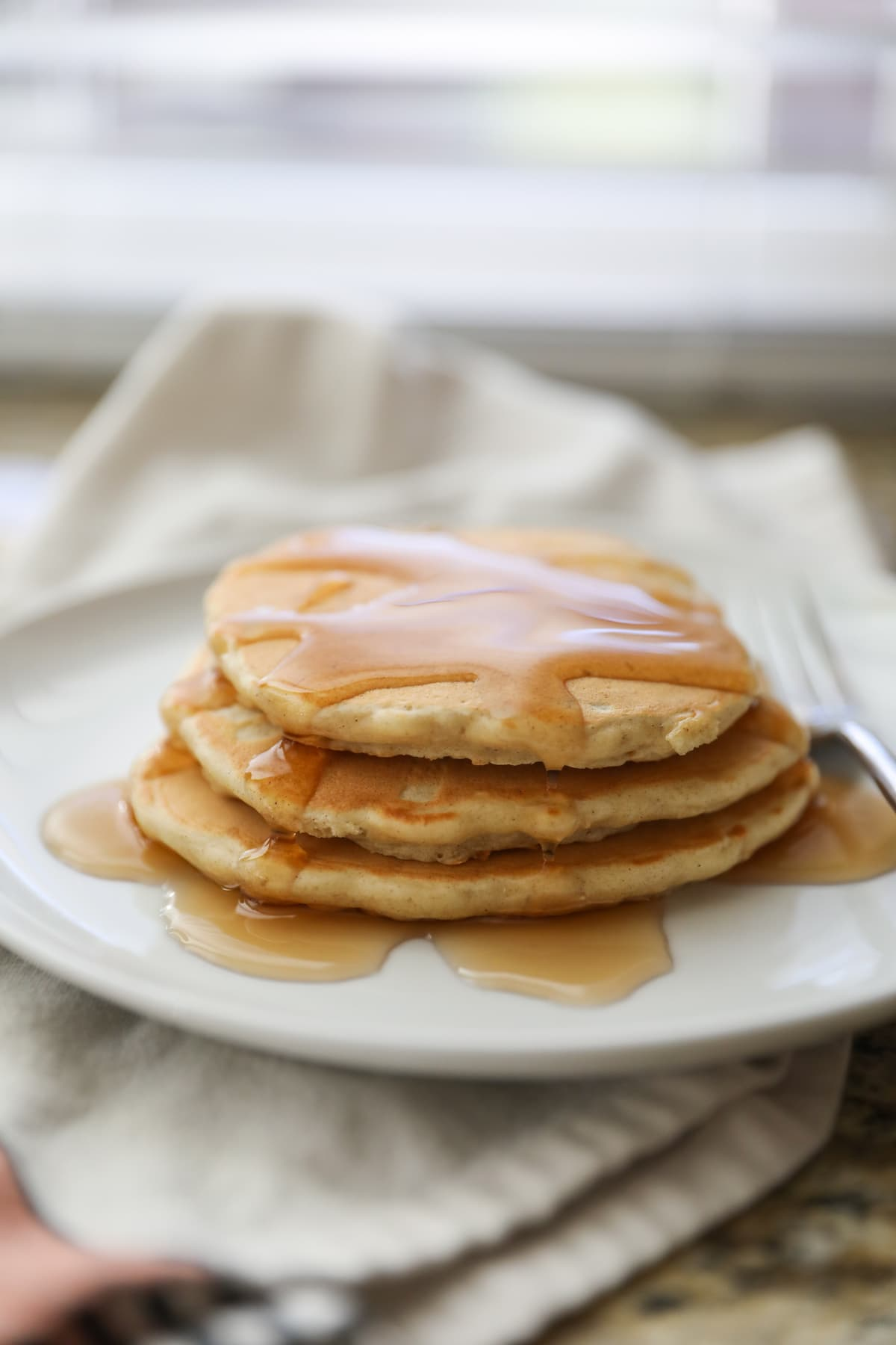 syrup on oatmeal pancakes
