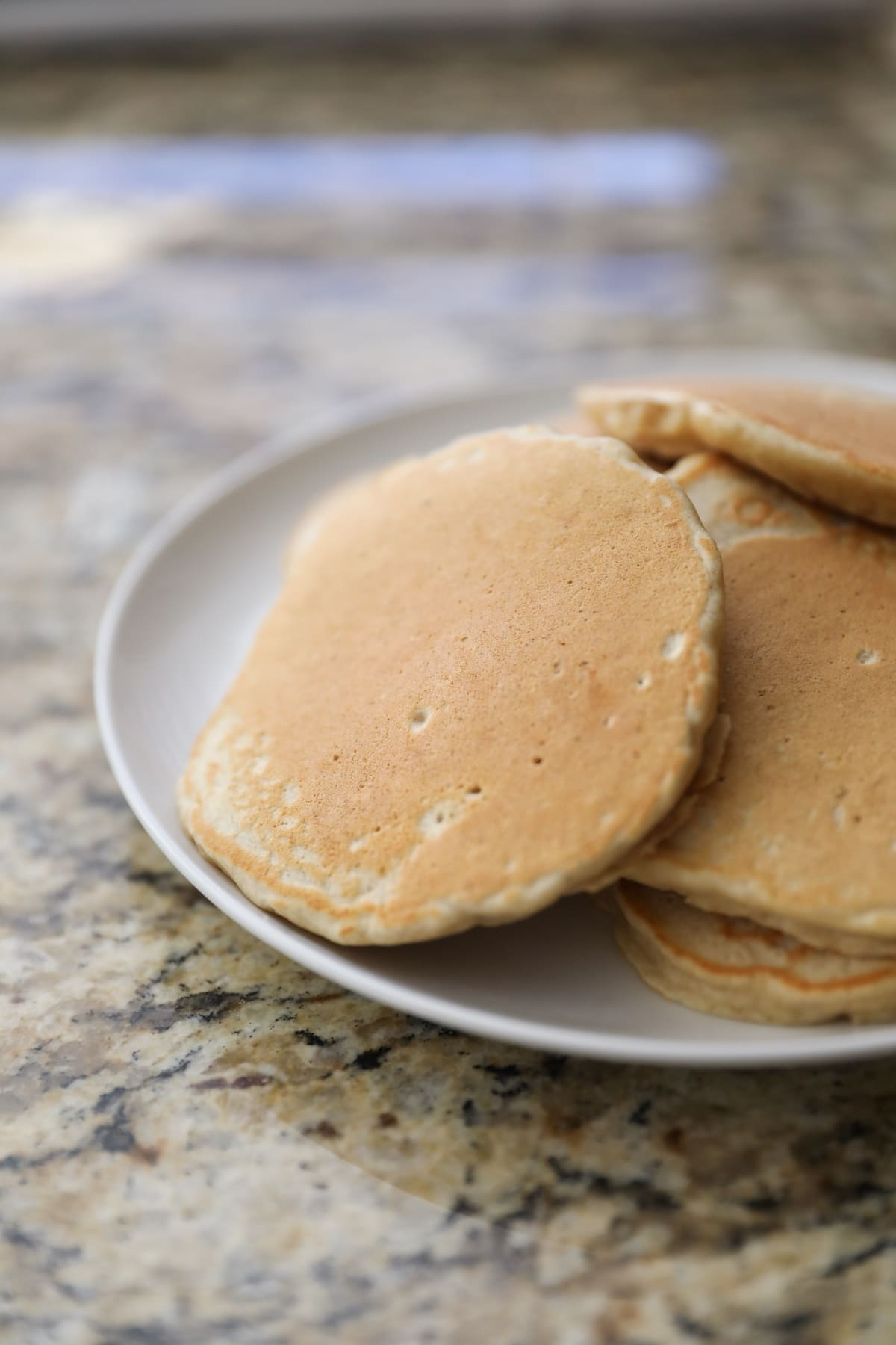 oatmeal pancakes on white plate
