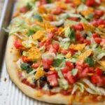 taco pizza on baking sheet