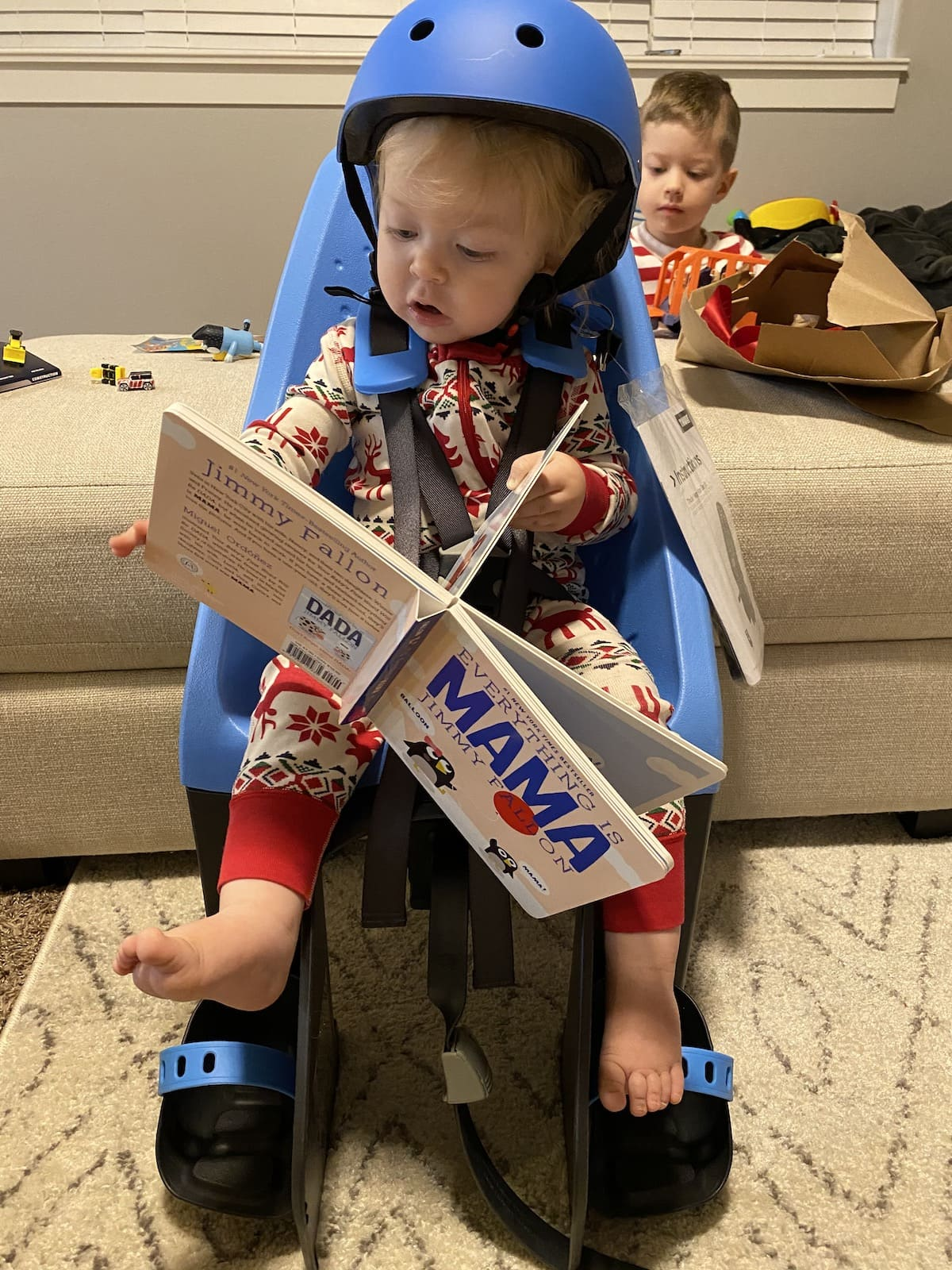 baby reading book in bike seat