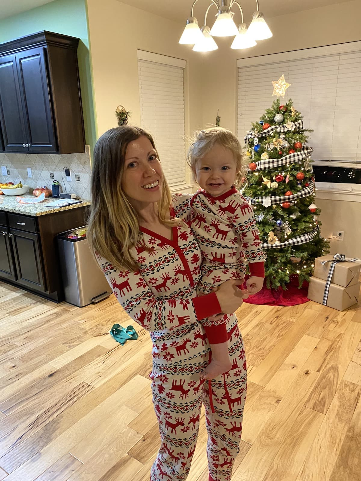 mom holding baby in christmas pajams
