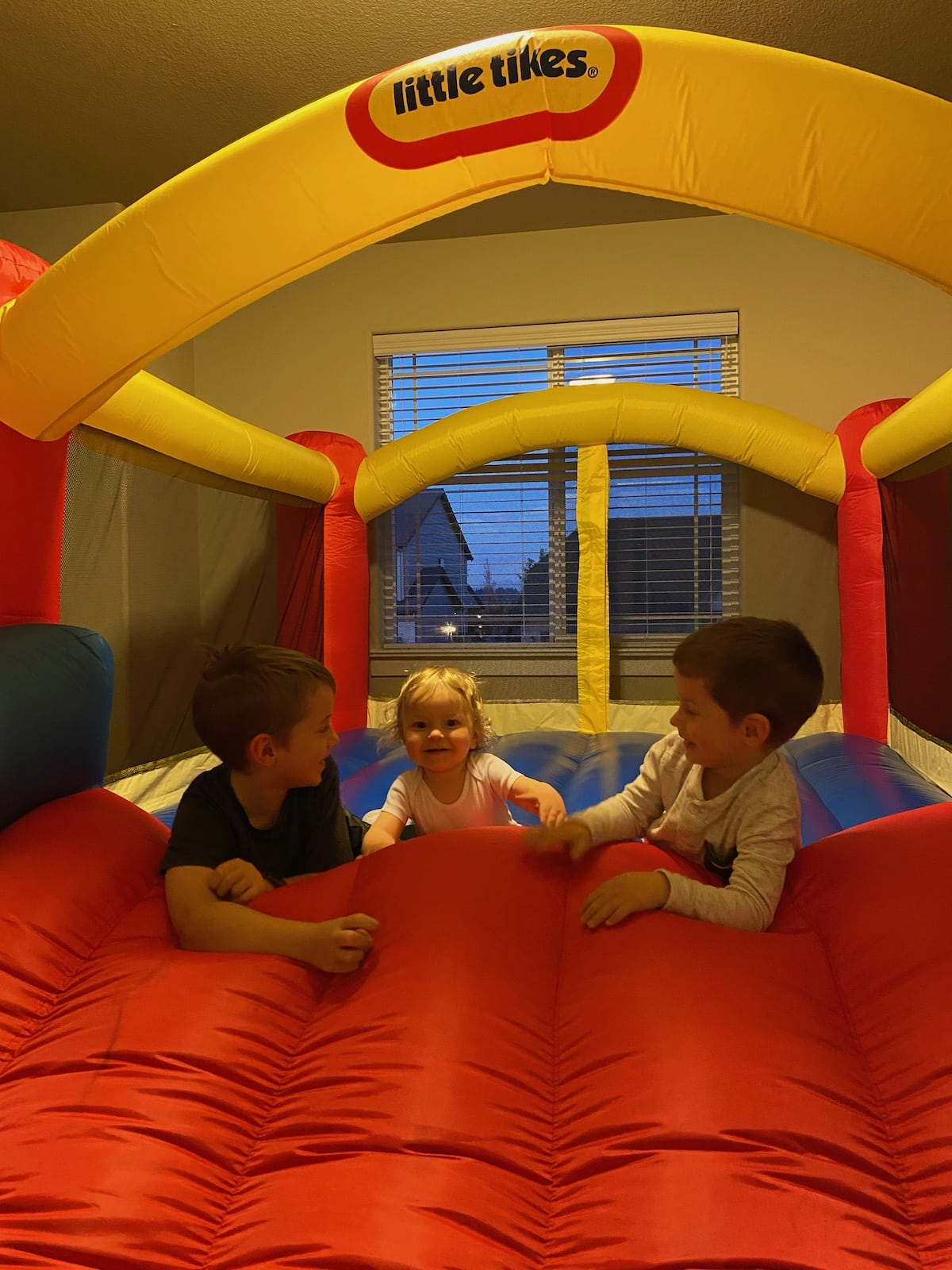 three boys in bounce house