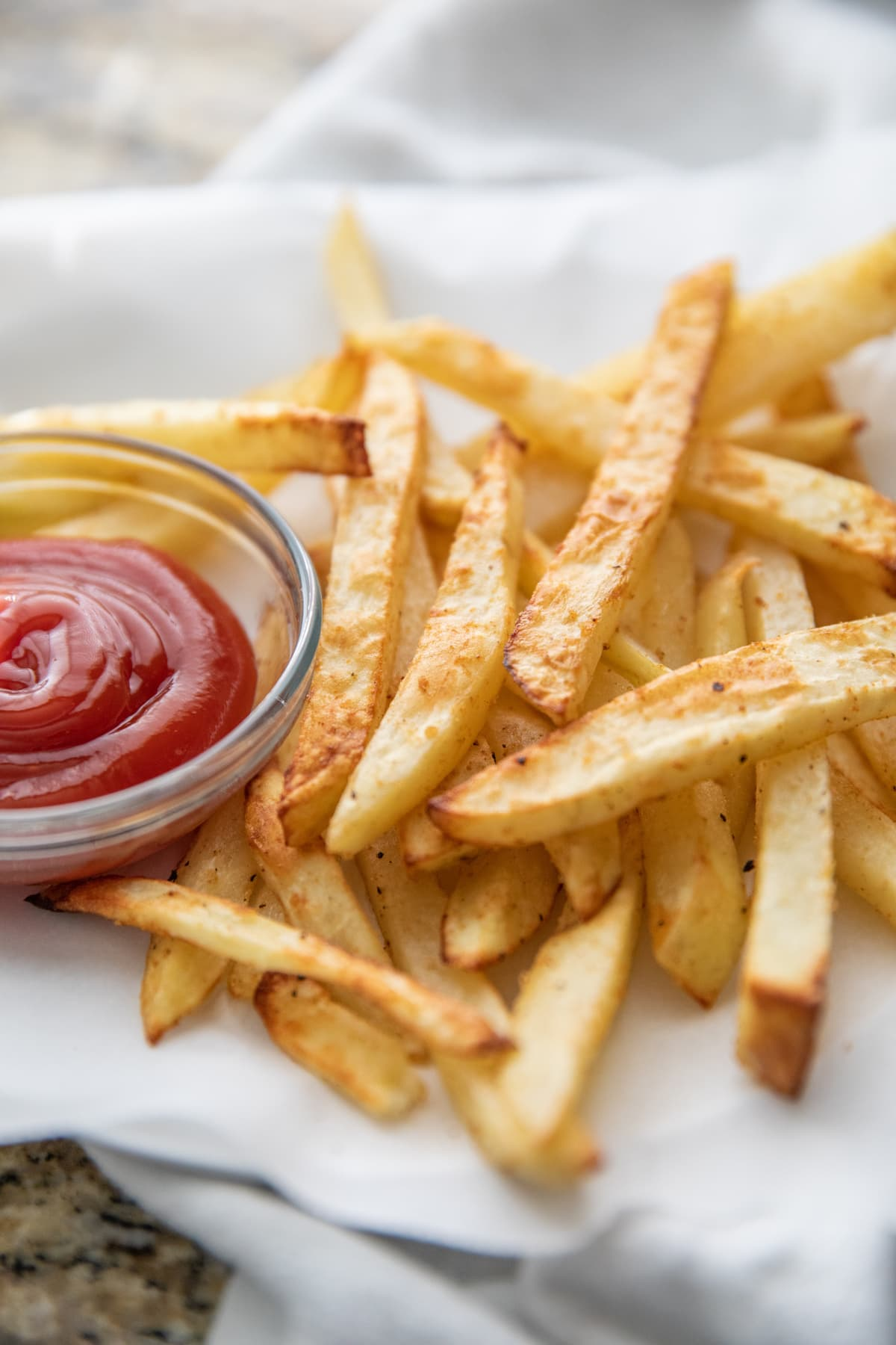 air fryer french fries on plate with ketchup