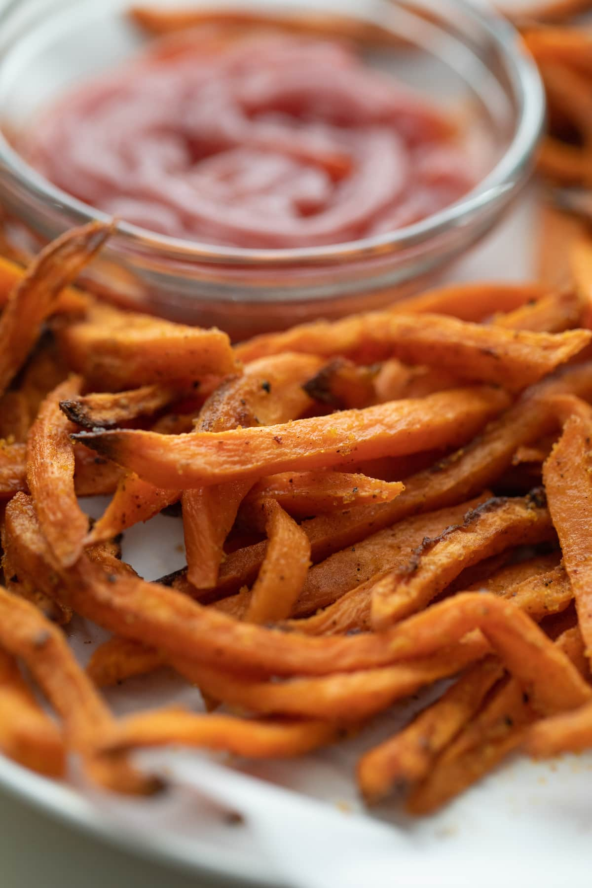 sweet potato fries on plate with ketchup