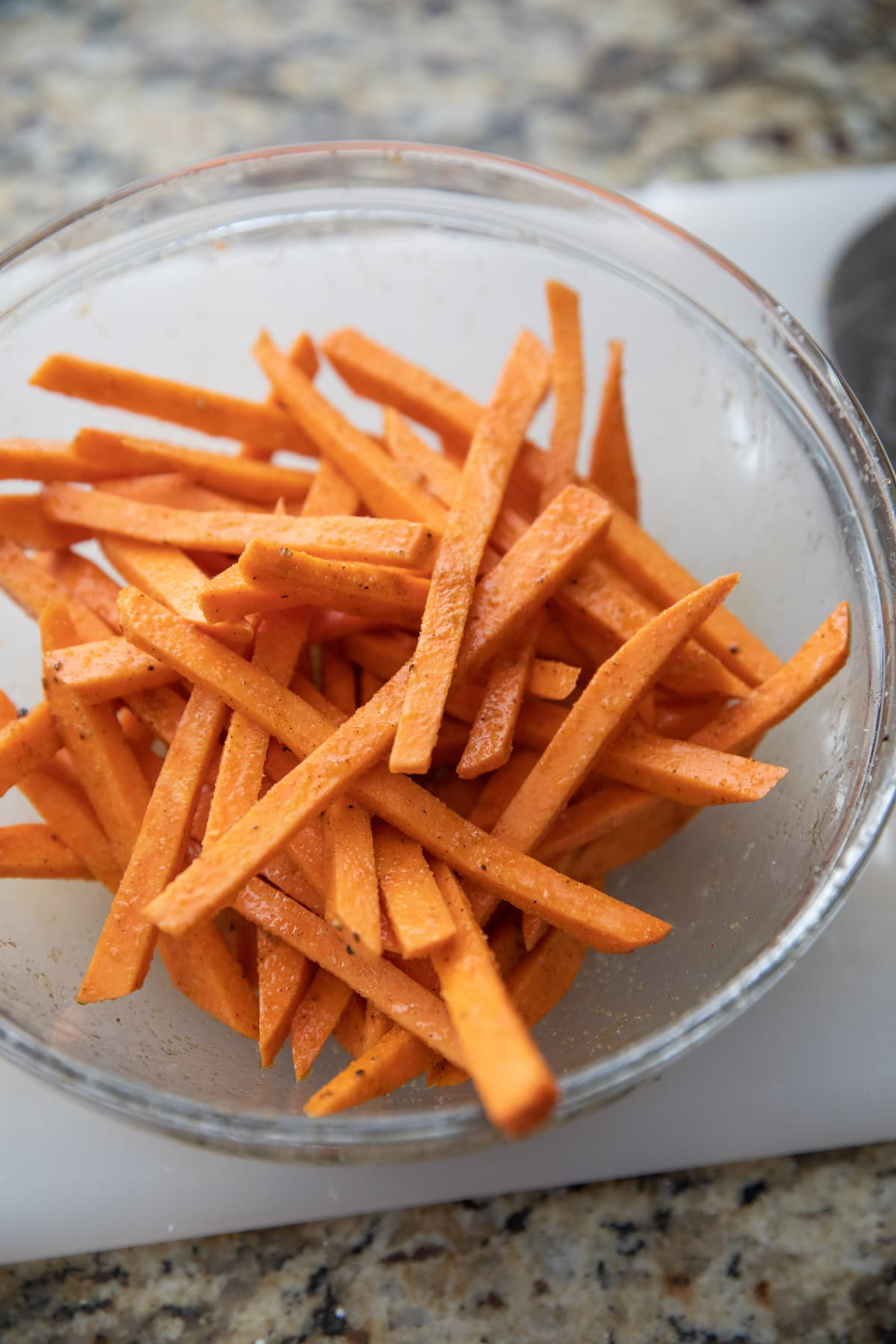 unbaked sweet potato fries in bowl