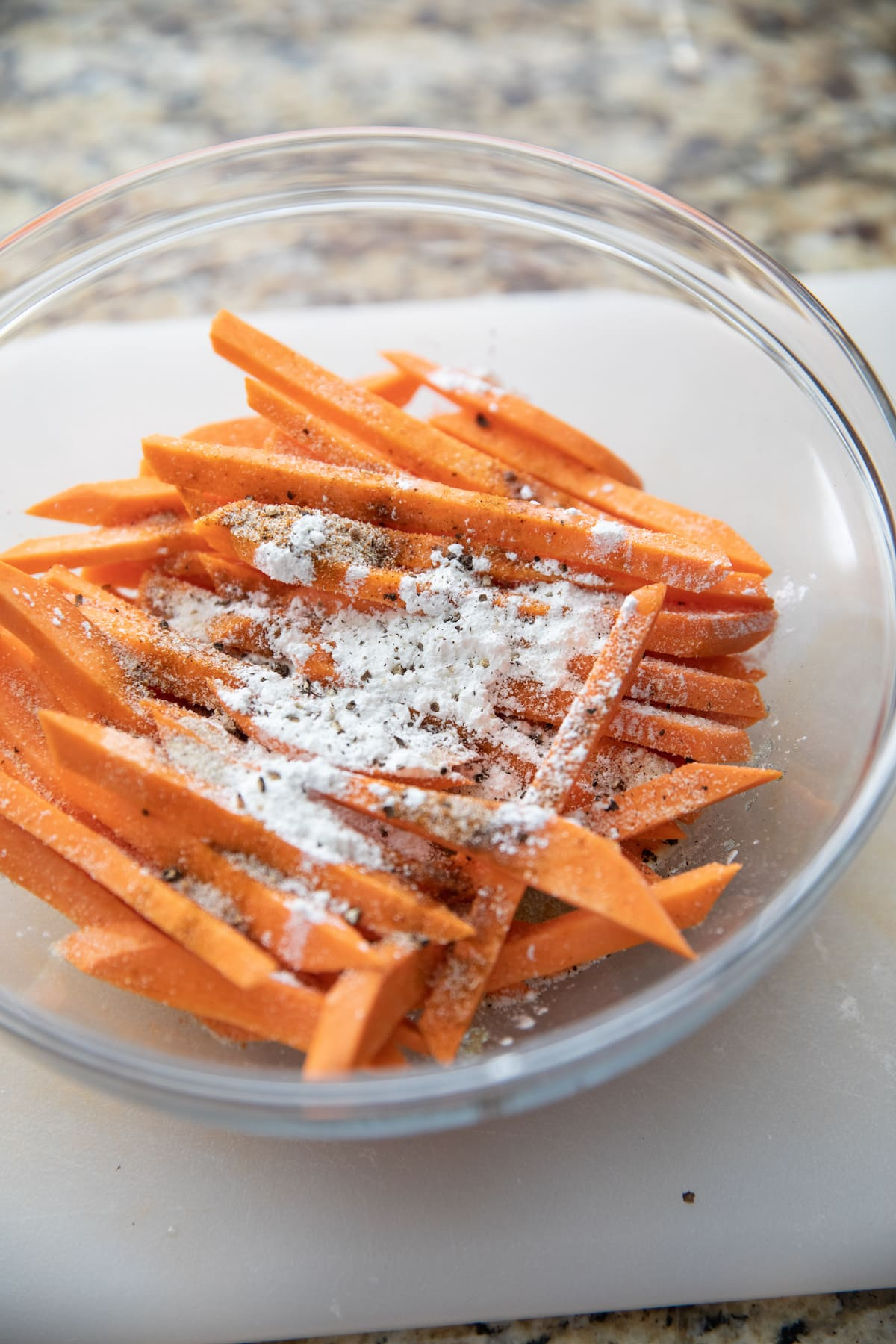 cut sweet potato fries with spices in bowl