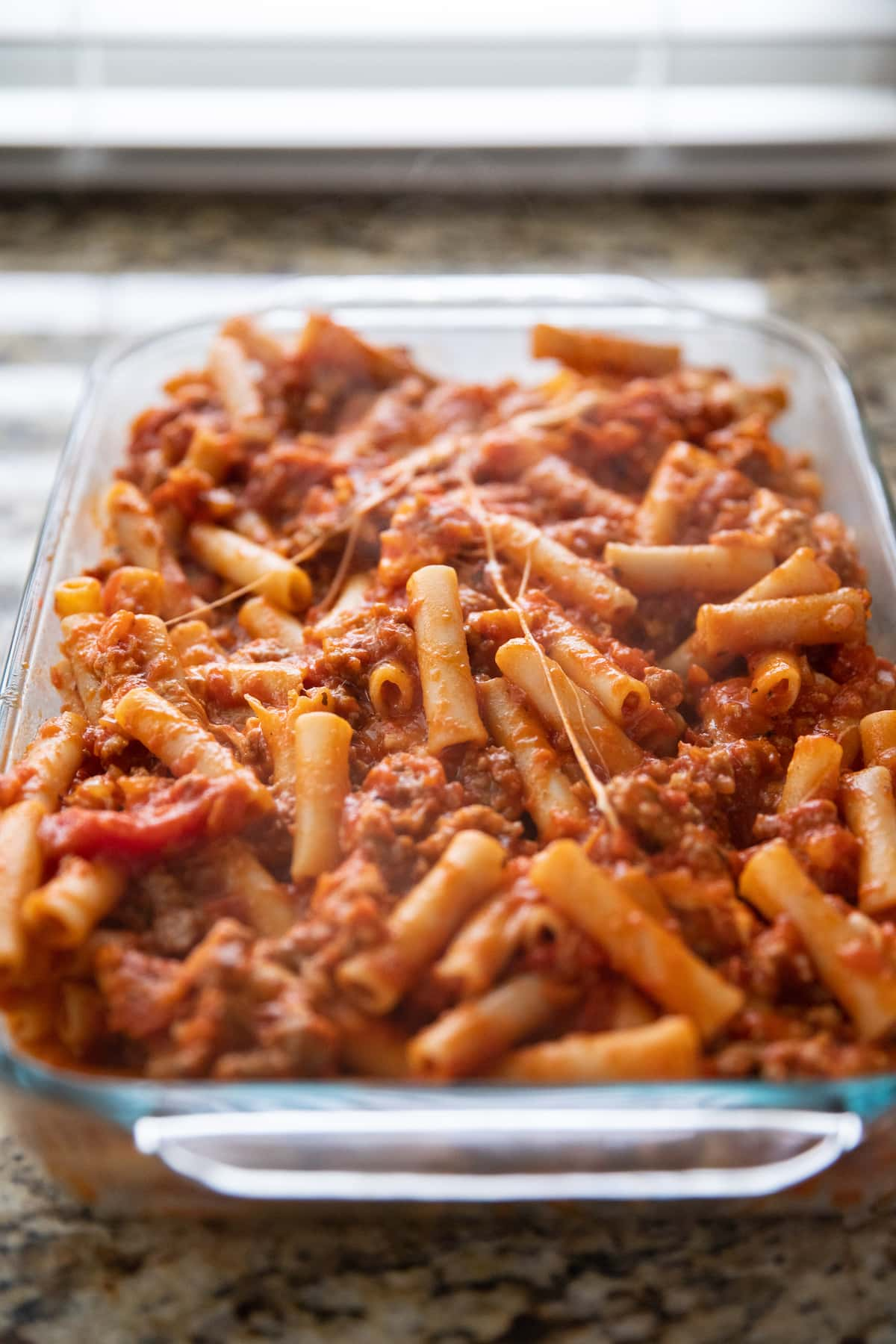 baked ziti in baking dish before baking