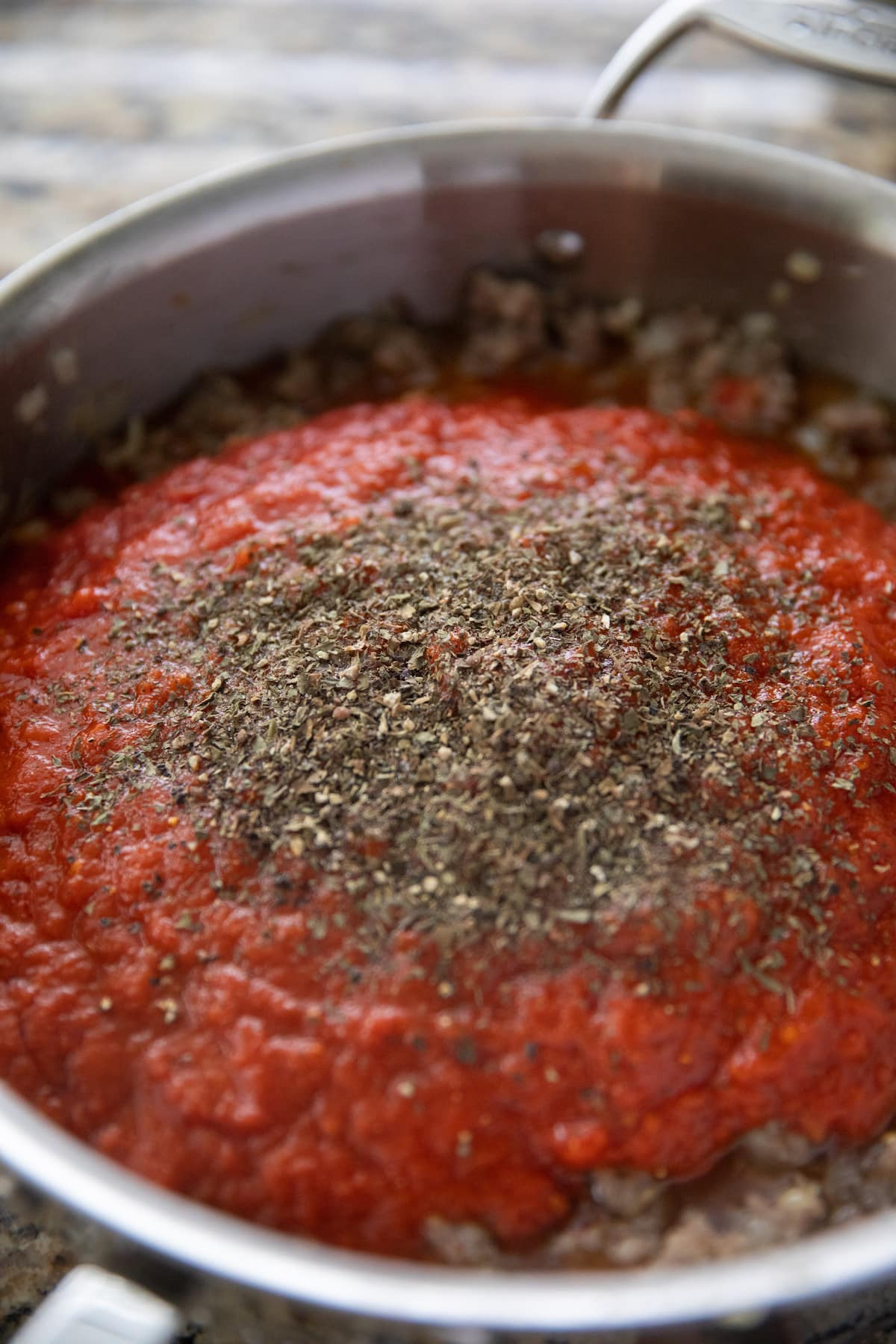 marinara, tomatoes and spices added to deep skillet