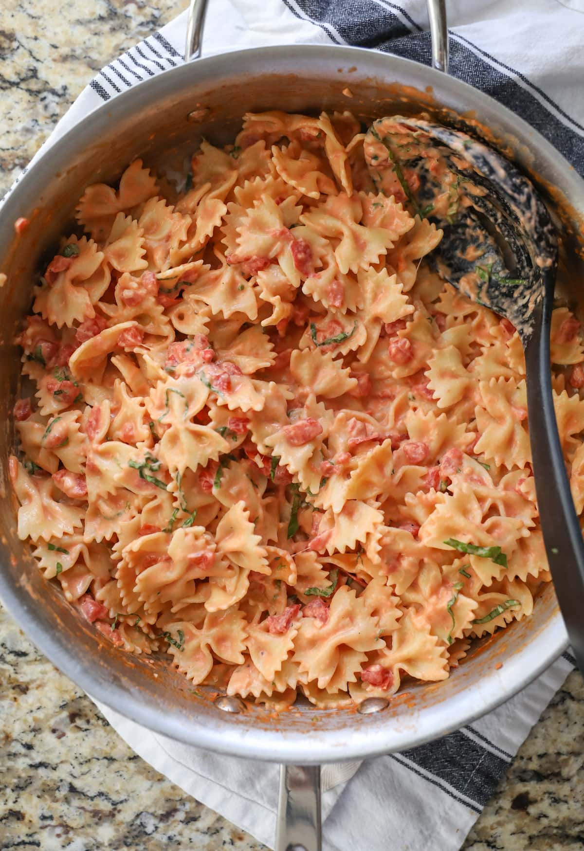 bow tie pasta with sauce in pan