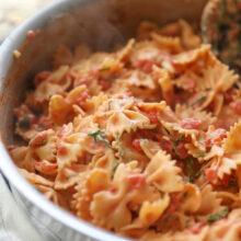 creamy tomato bow tie pasta in pan