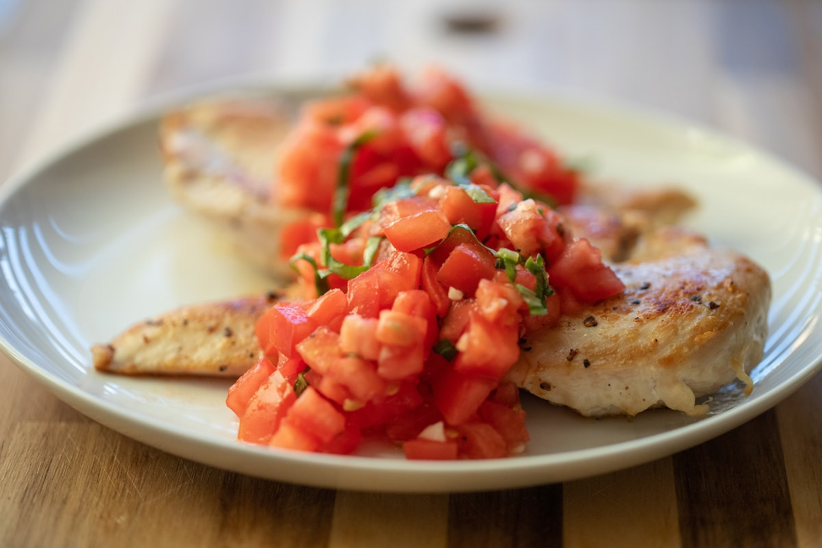 bruschetta chicken on white plate