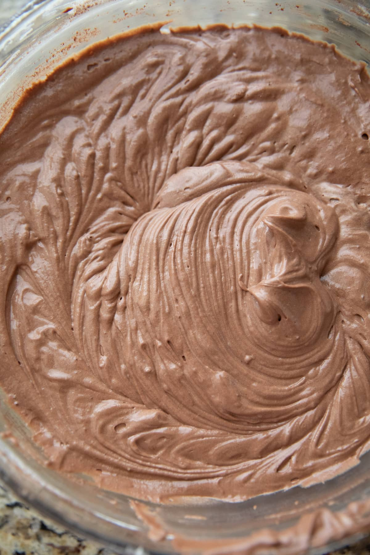chocolate cake batter in glass mixing bowl