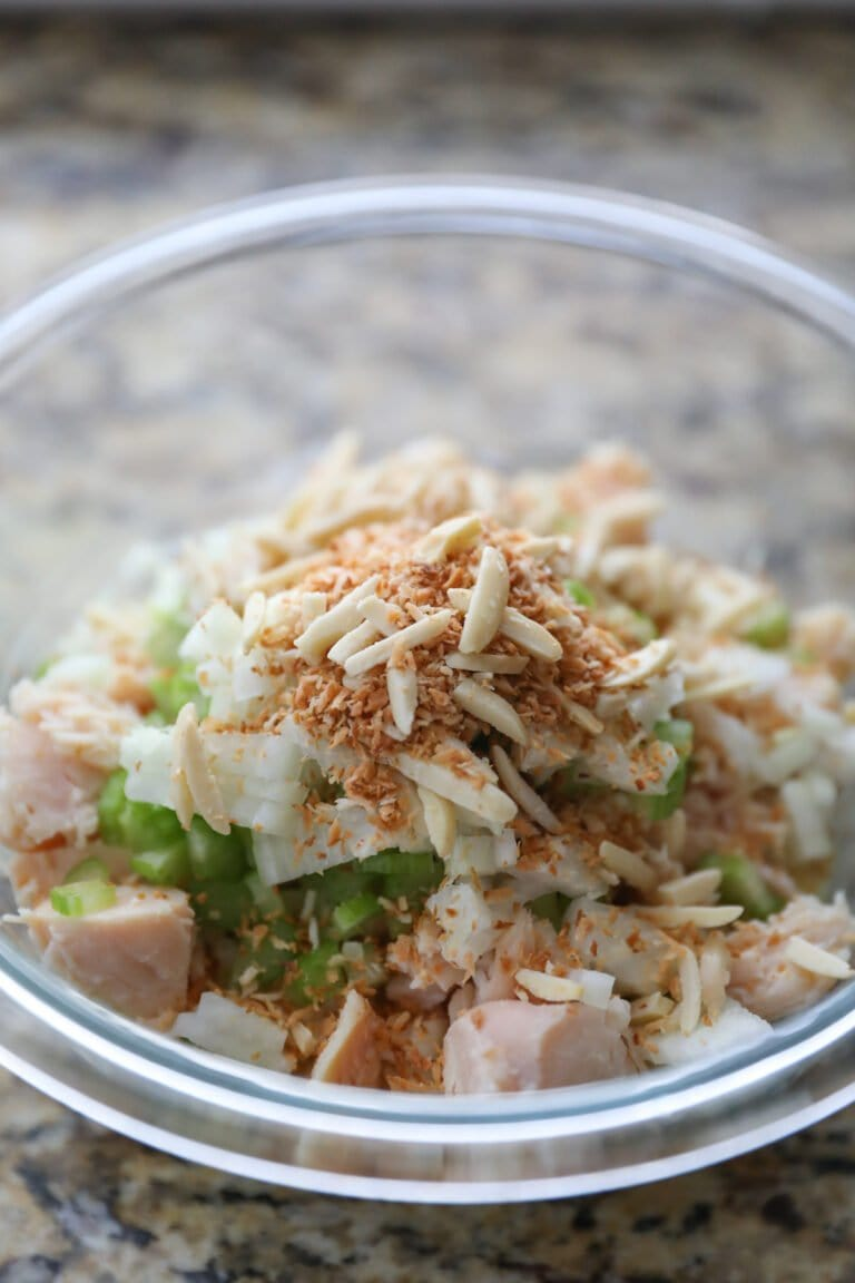 curry chicken salad ingredients in a glass bowl