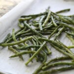 roasted green beans on baking tray