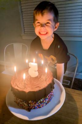 boy smiling with birthday cake