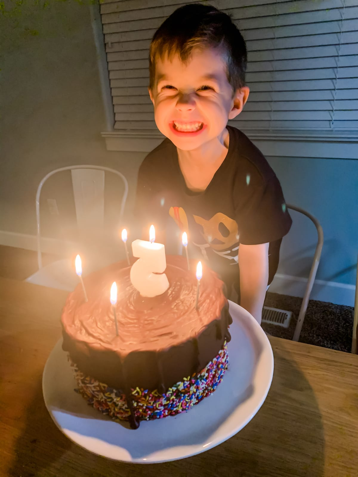 boy smiling with birthday cake