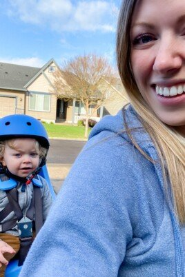 mom on bike with baby in bike seat