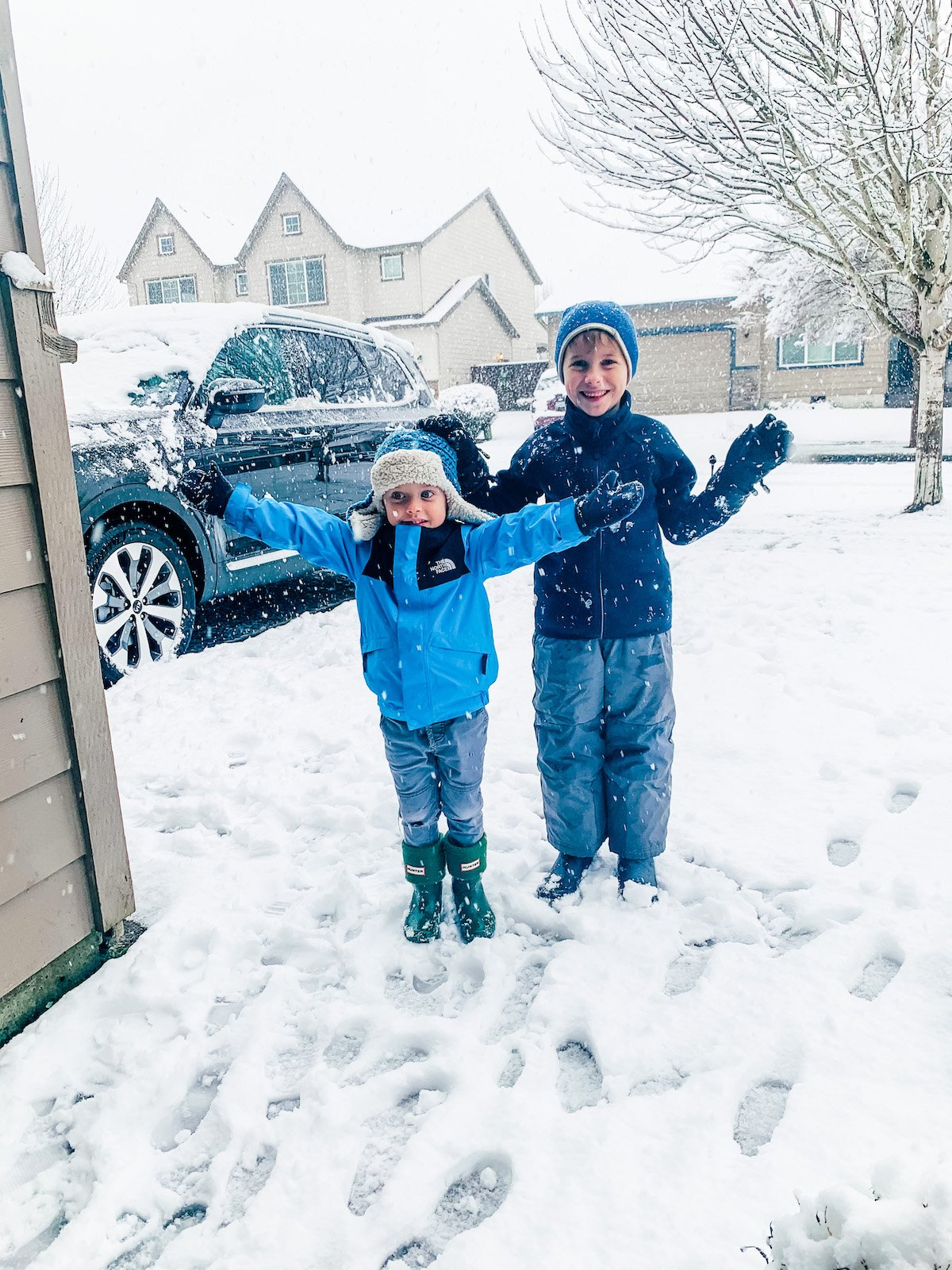 two boys outside in the snow