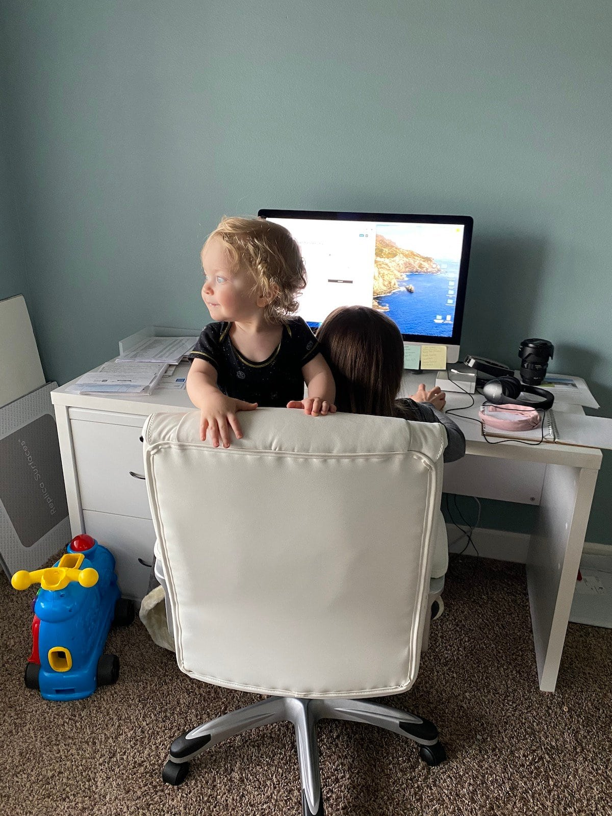 baby with mom on chair