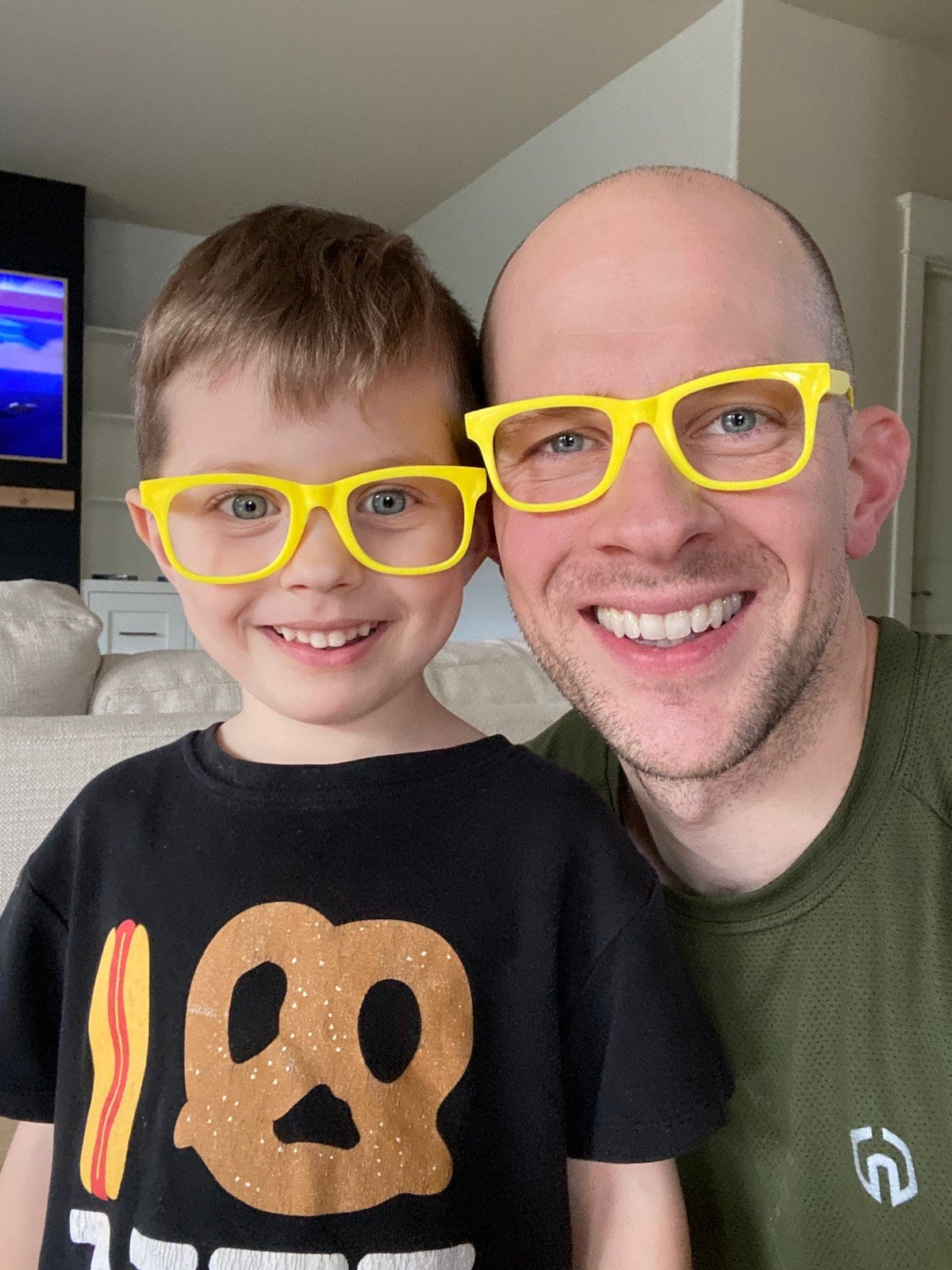 father and son with matching glasses