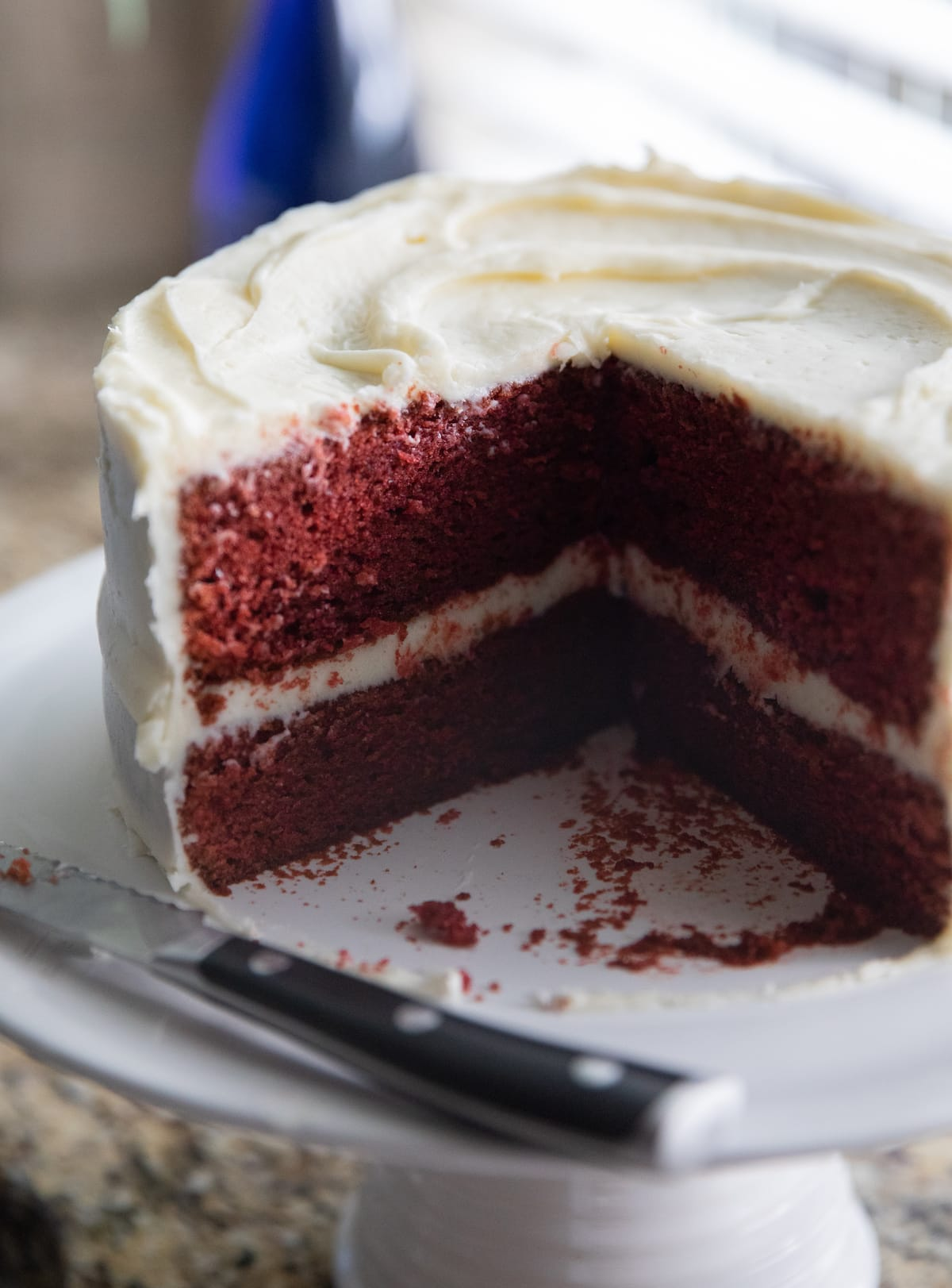 red velvet cake with slices missing