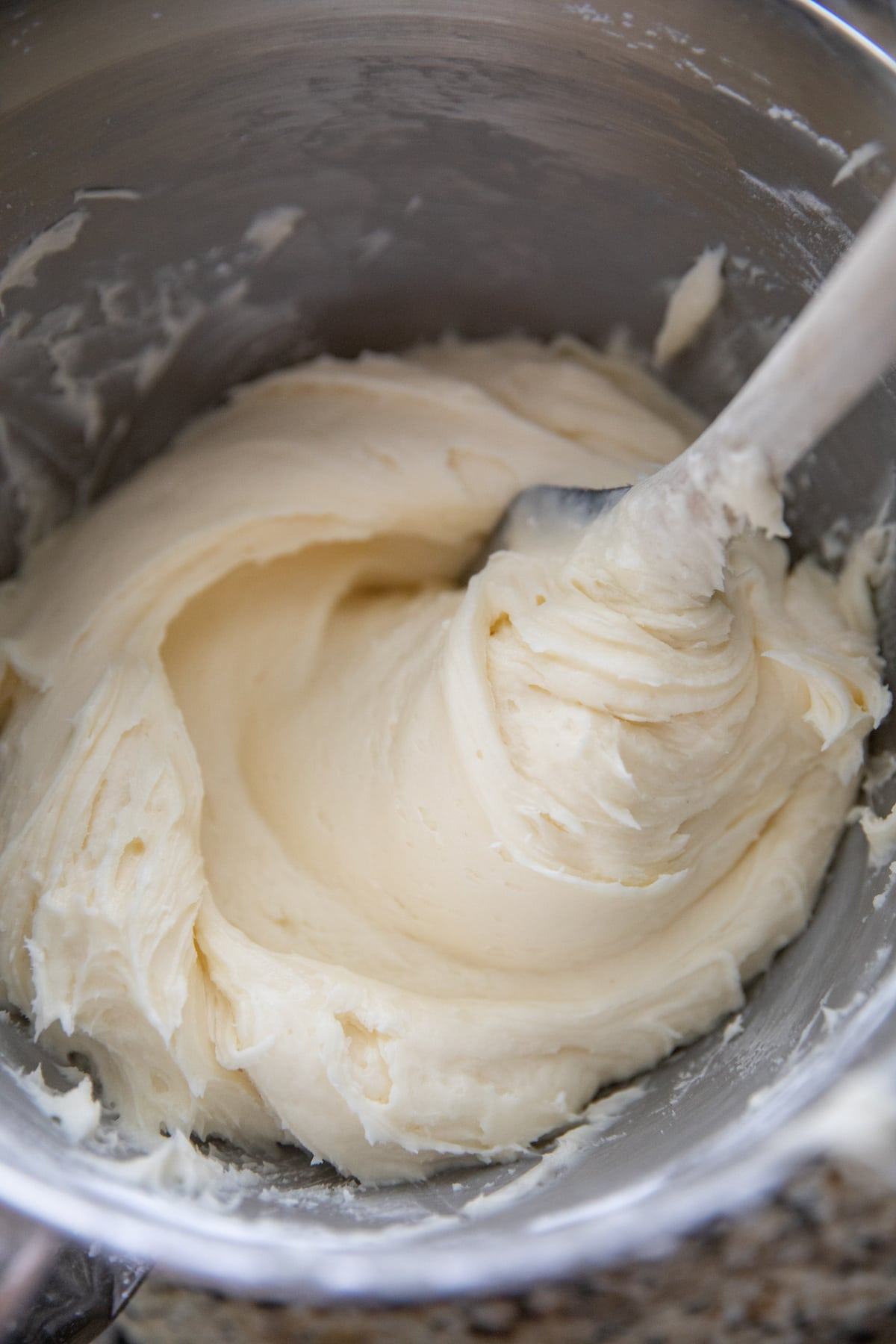 cream cheese frosting in mixing bowl