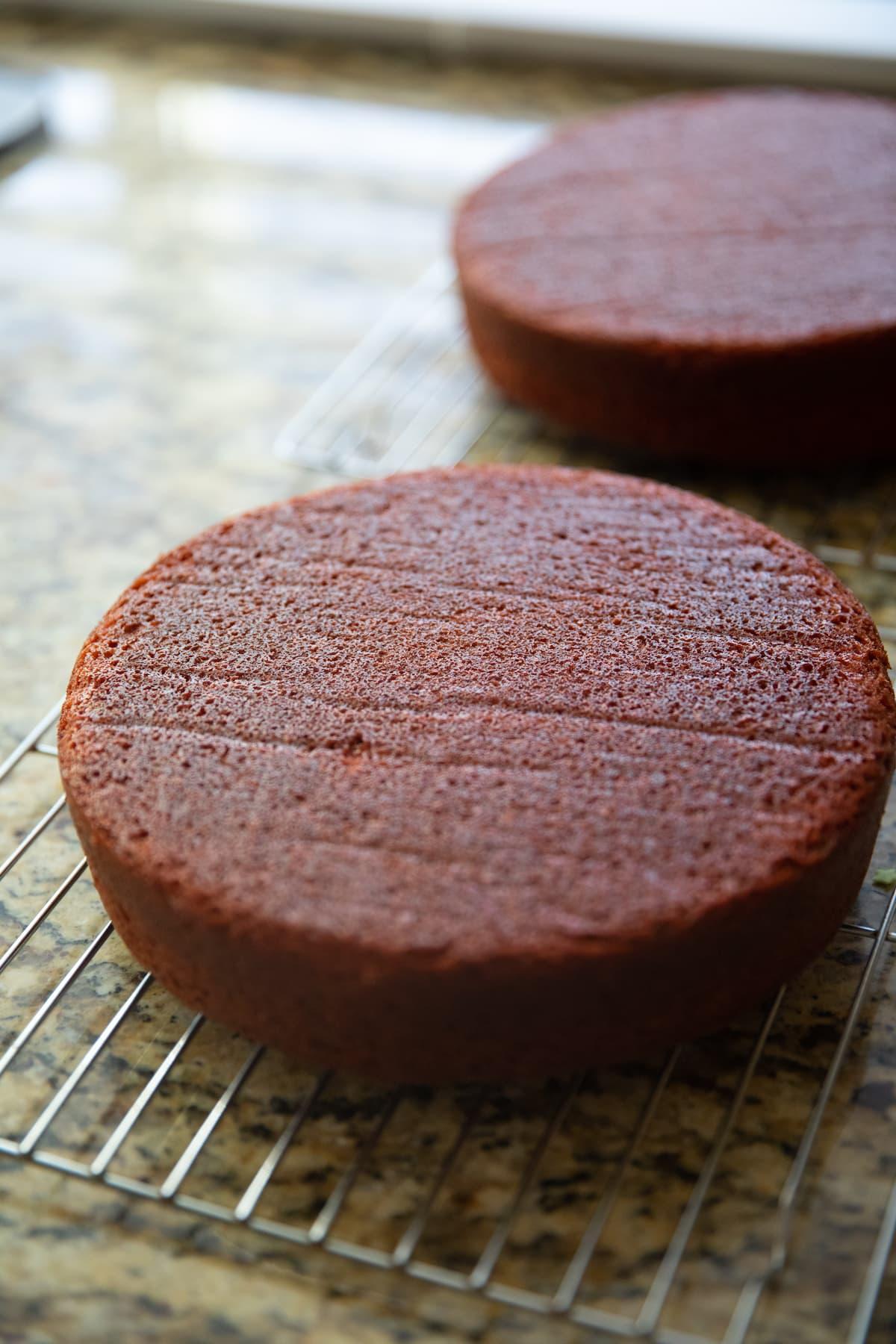 red velvet cakes cooling on cooling racks