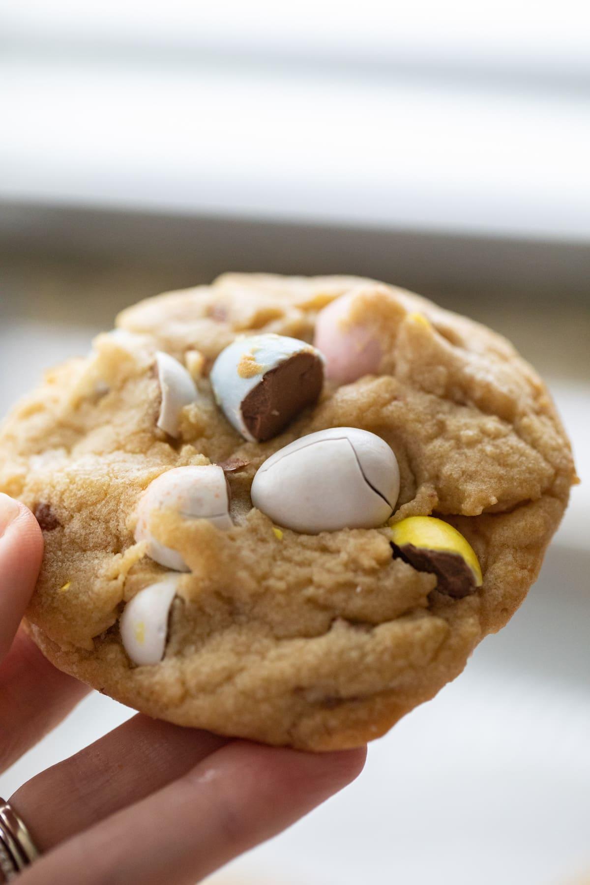 hand holding cadbury egg cookie