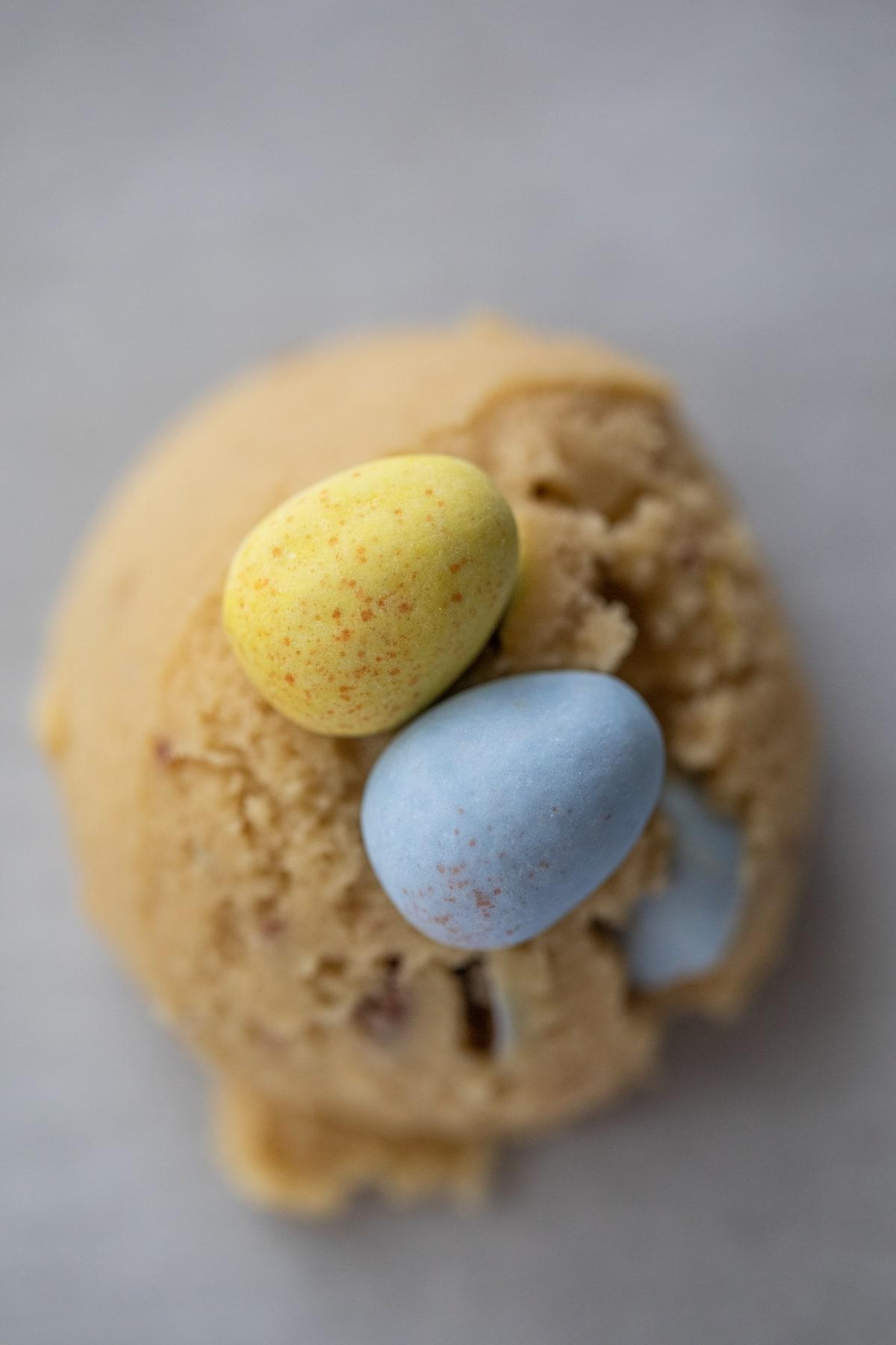 cadbury eggs pressed into cookie dough