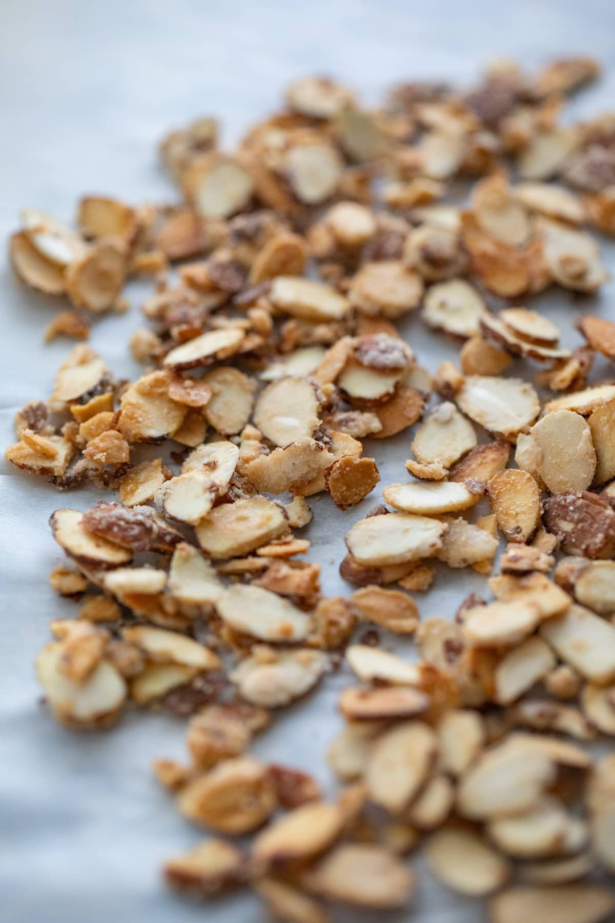 candied almonds on parchment paper