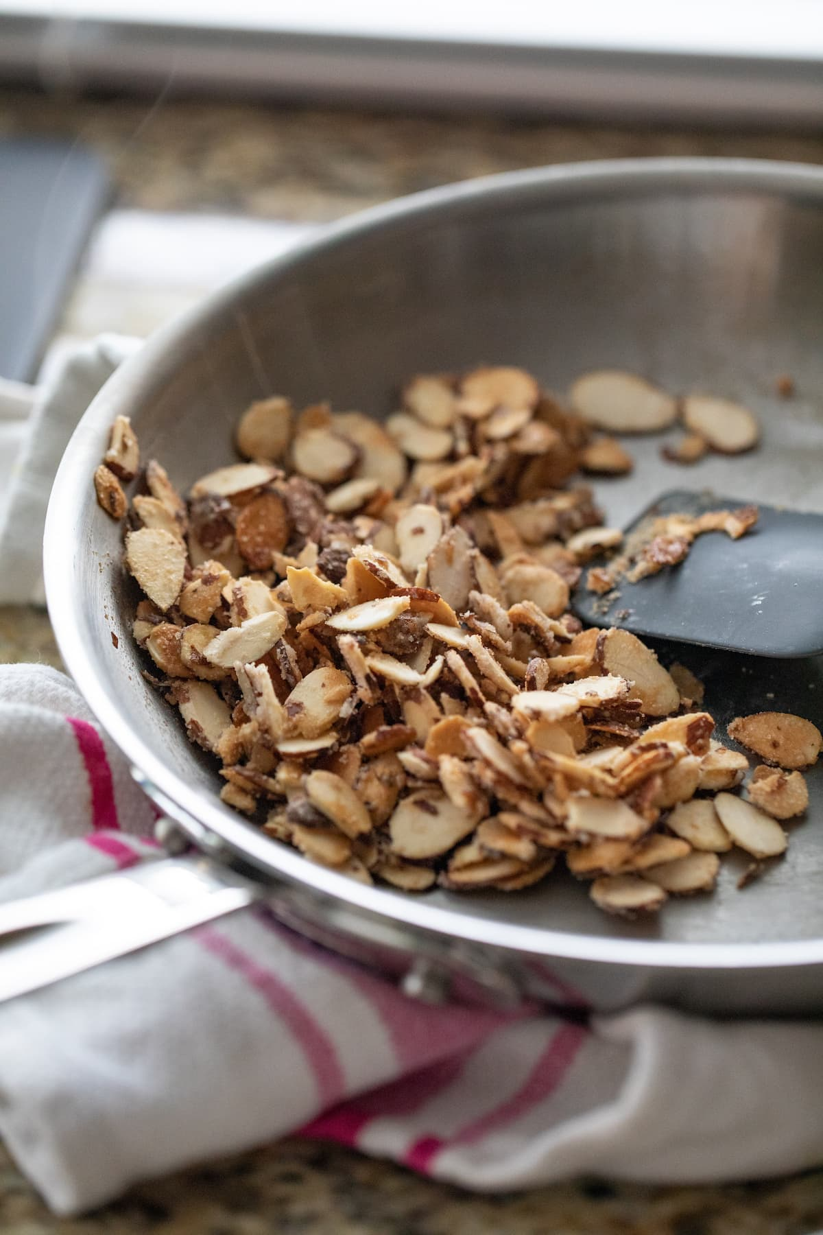 stirring the almonds with sugar in pan