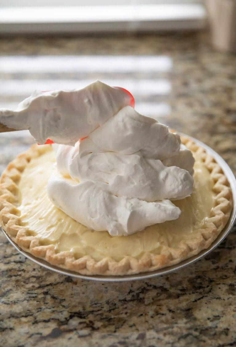adding cream to top of pie