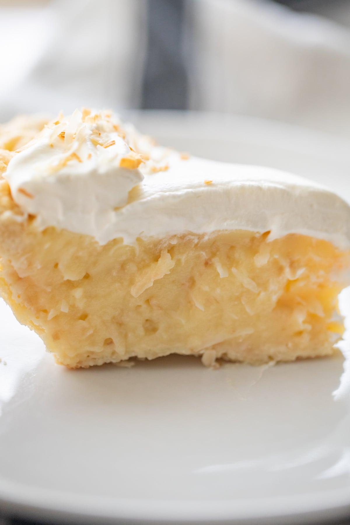 slice of coconut cream pie on plate