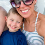 mom with sunglasses smiling with boy