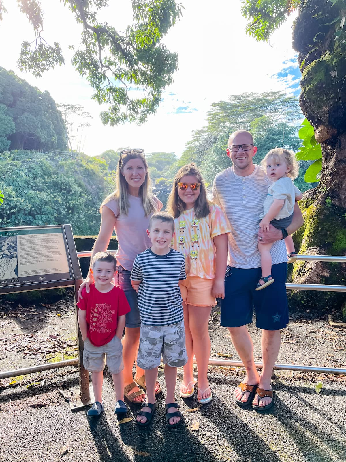 family posing for picture in hawaii