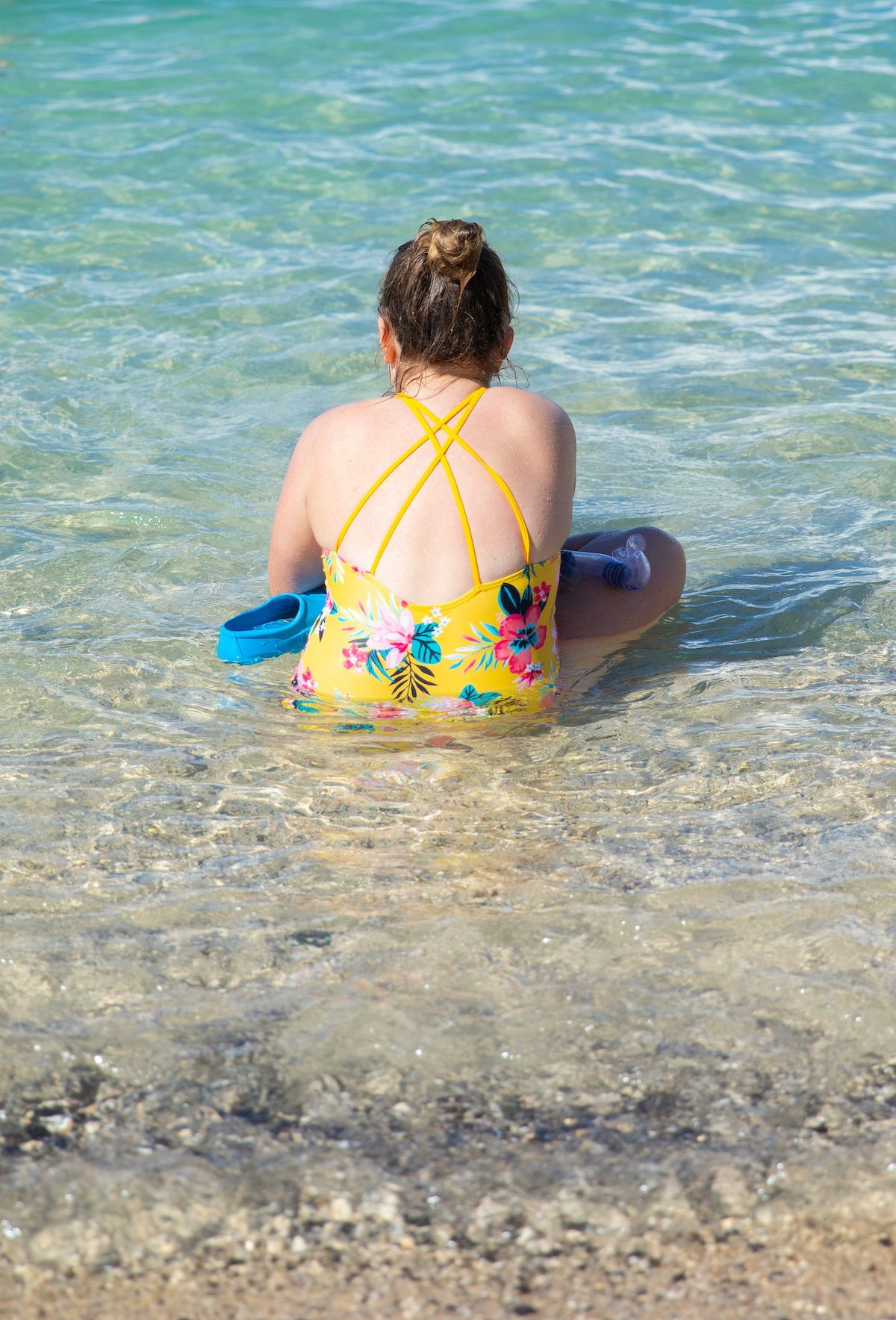 girl sitting in ocean