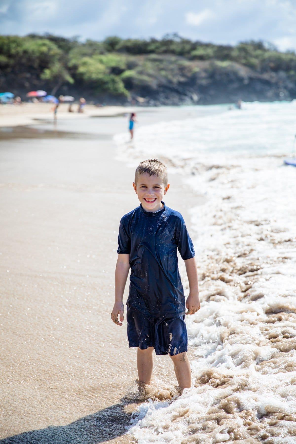 boy smiling on beach