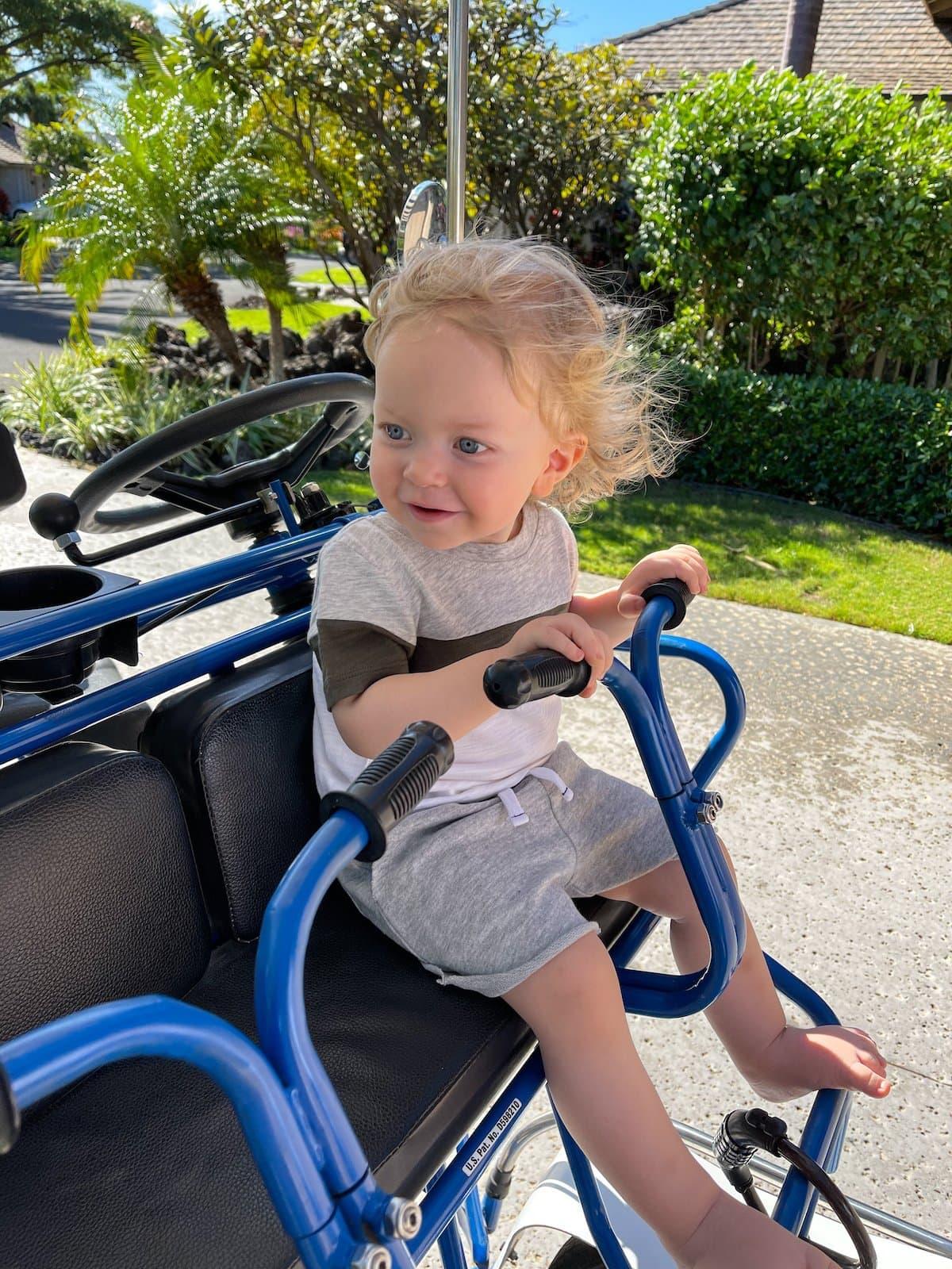 toddler on surrey bike