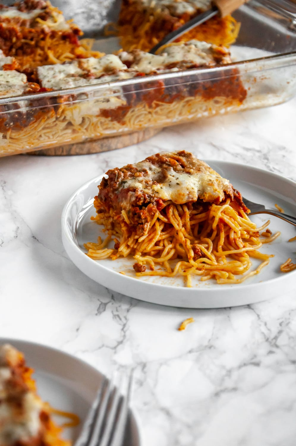 slice of baked spaghetti on a white plate
