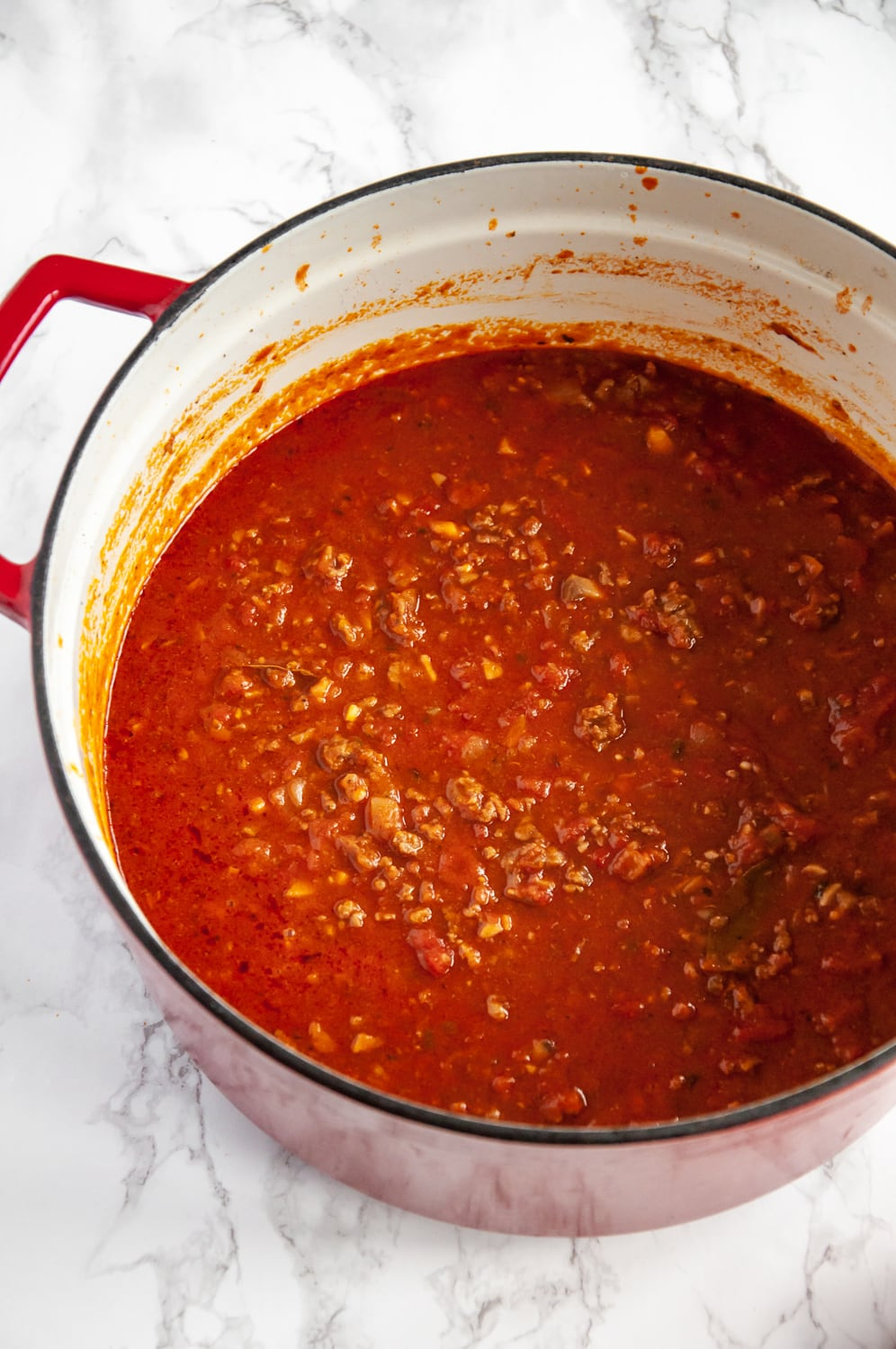 red sauce in a red cooking pot