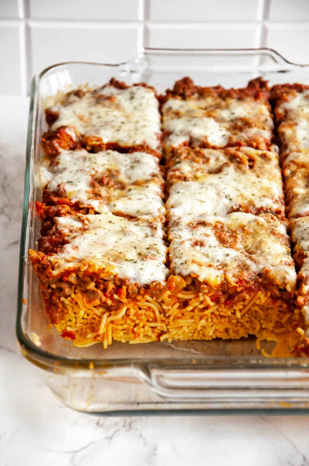 baked spaghetti sliced in a baking dish