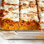 sliced baked spaghetti in a glass baking dish