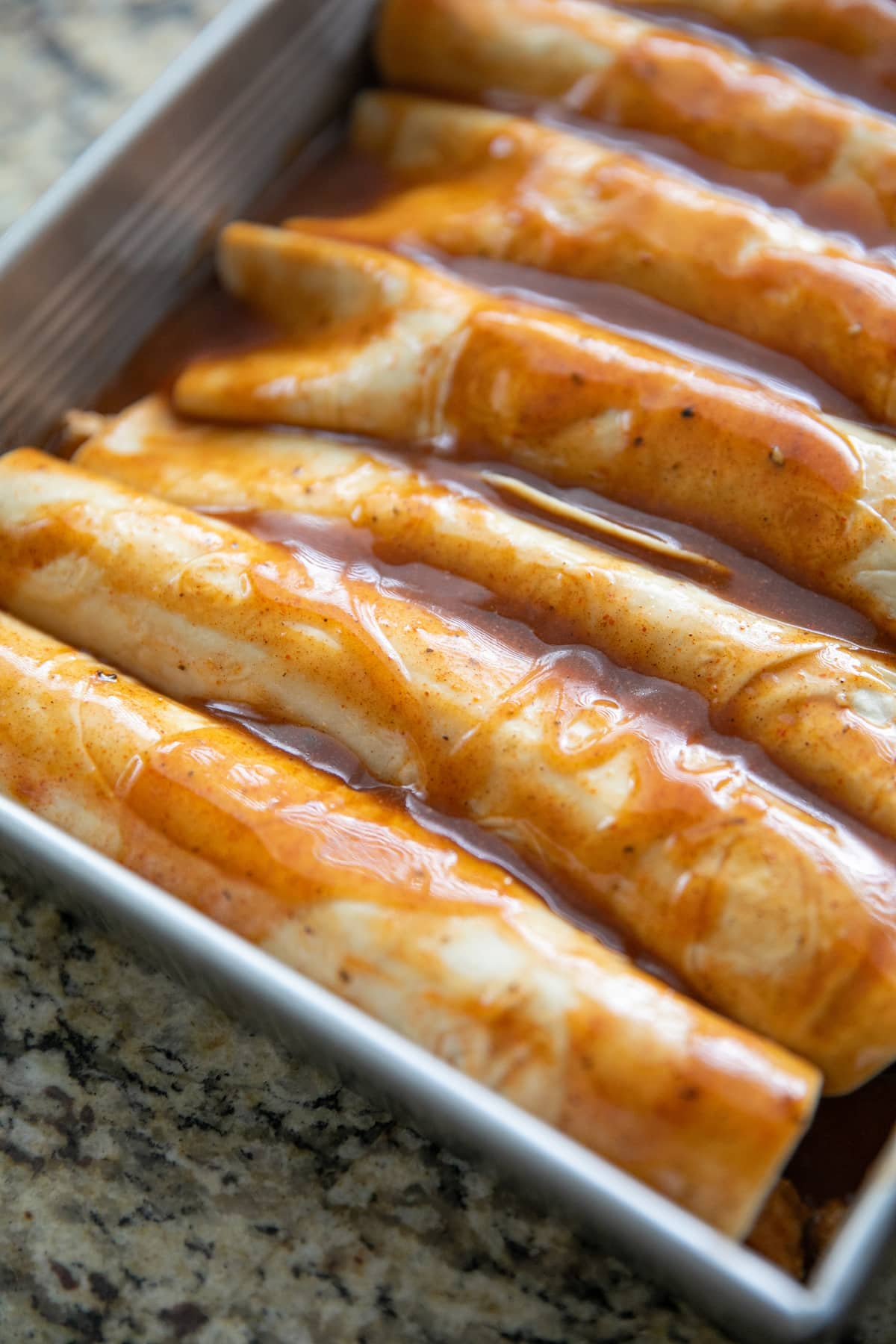 unbaked enchiladas in pan