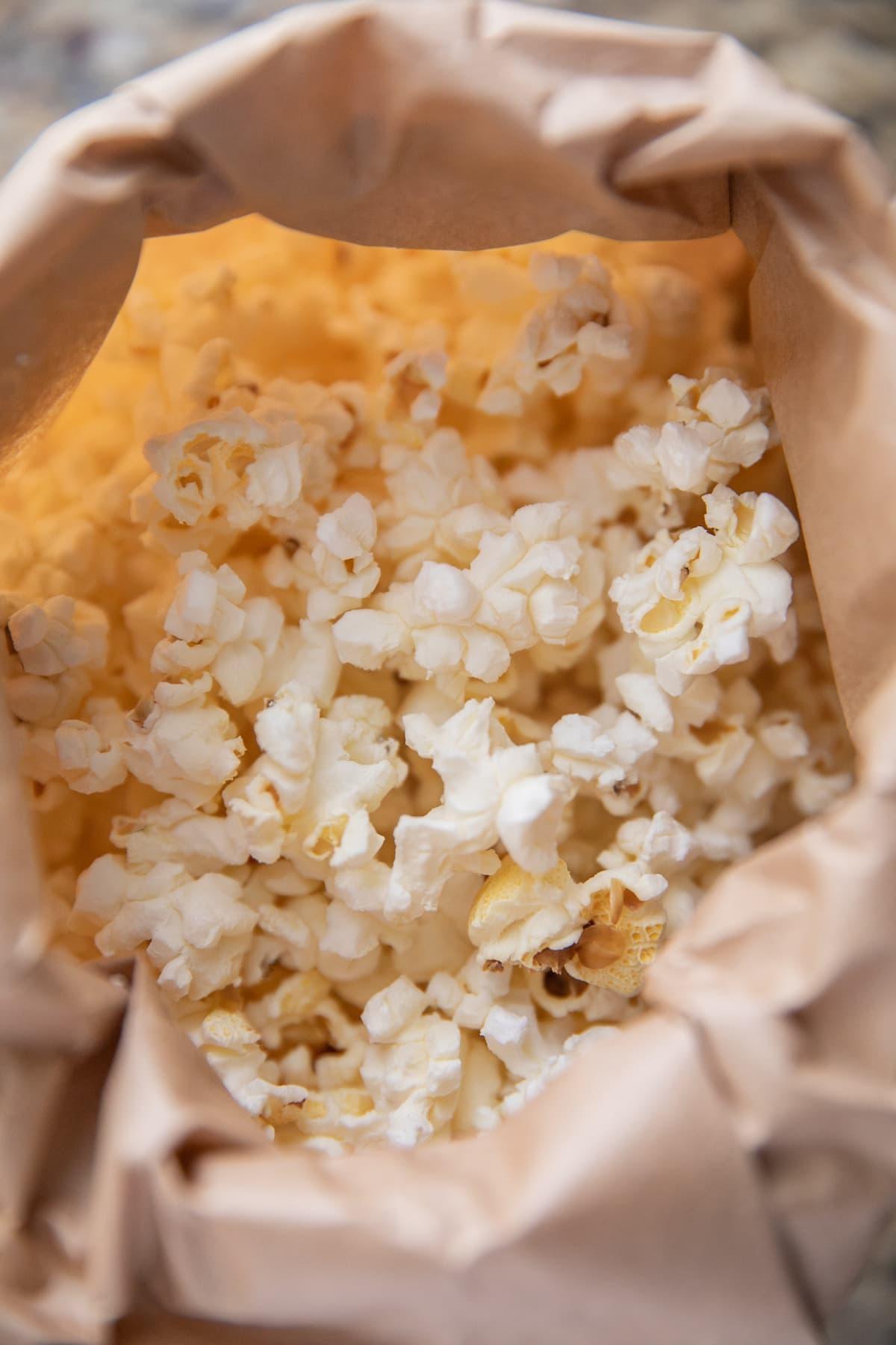 popped popcorn in brown paper bag