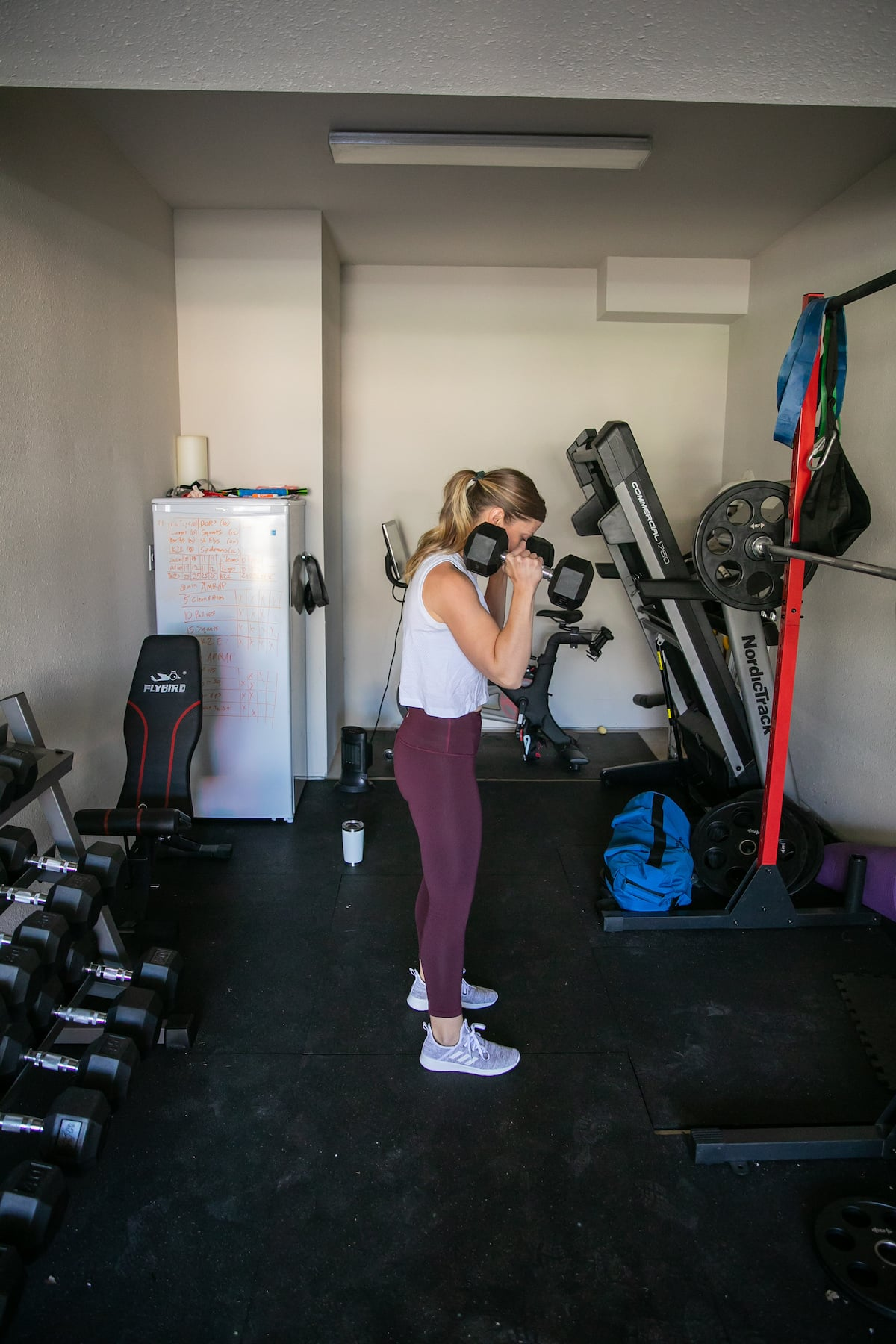 woman exercising in home gym
