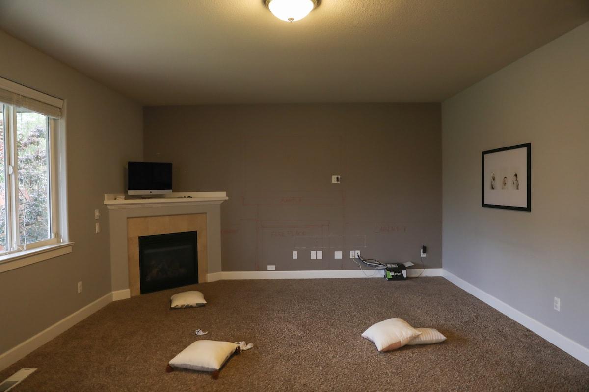 dark living room with corner fireplace