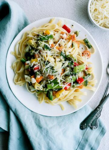 top down view of pasta primavera on a white plate