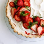 strawberry jello pie with whipped cream on top